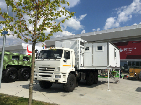 Специальный автомобиль с изотермическим кузовом переменного объема на шасси а/м КАМАЗ